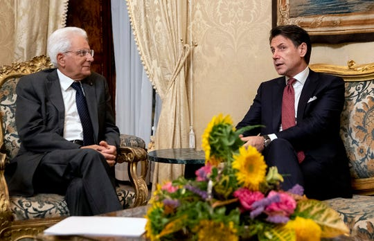 Italian Prime Minister, Giuseppe Conte, right, meets President Sergio Mattarella at the Quirinale presidential palace in Rome, Tuesday, Aug. 20, 2019. Italian Premier Giuseppe Conte has told senators he's handing in his resignation because his right-wing coalition partner has yanked its support for the populist government. Conte blamed his rebellious deputy prime minister Matteo Salvini who triggered a political crisis in a gambit to force early elections that could bring the right-wing, anti-migrant leader to power.