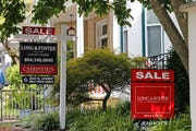 For sale signs beckon buyers to homes along Park Avenue in Richmond, Va.