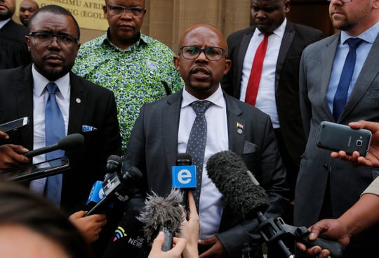 Nelson Mandela Foundation's CEO, Sello Hatang, speaks to the press on the steps of the Johannesburg High Court, Wednesday, August 21, 2019.  S