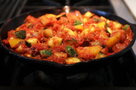 Ratatouille typically consists of roughly equal amounts of eggplant, zucchini and bell pepper, flavored with onion, garlic and herbs. Tomato is added in direct proportion to the cook's tastes.