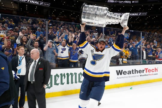 St. Louis Blues left wing Mackenzie MacEachern hoists the Stanley Cup after the Blues' Game 7 victory over the Boston Bruins. MacEachern is a former Michigan State player and Bloomfield Hills native.