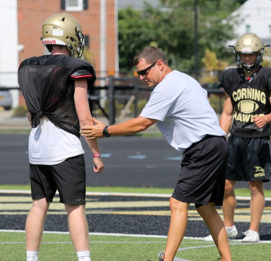 Corning assistant football coach Mike Johnston instructs players during practice Aug. 21, 2019 at Corning Memorial Stadium.