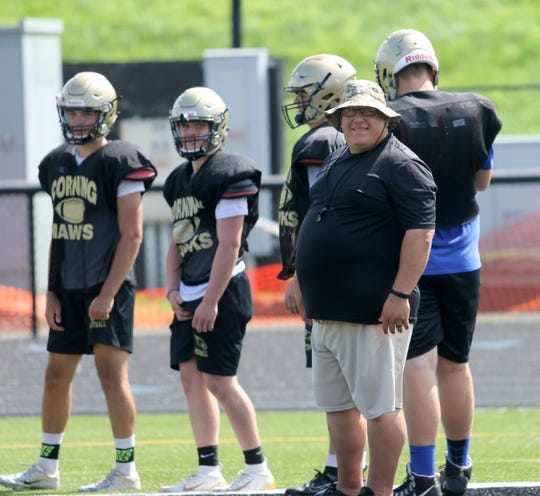 Corning head football coach George Bacalles smiles after watching a player run through a drill at practice  Aug. 21, 2019 at Corning Memorial Stadium.