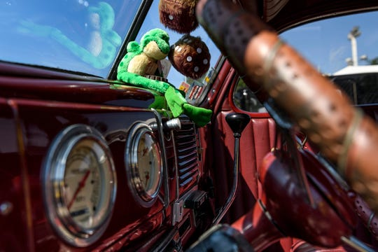 A plush frog sits on the dashboard of Glenda Lacer's 1939 Ford at the Vanderburgh 4-H Center, where the 45th annual Frog Follies will be taking place this weekend.