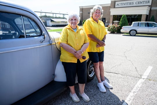 Linda Paris, left, and Glenda Lacer, right, members of the E'ville Iron Street Rod Club, sit on Paris' 1940 Ford two-door sedan at the Vanderburgh 4-H Center in Evansville, Ind., Wednesday, Aug. 21, 2019. They have been friends for over 40 years and continue to maintain their Ford cars to honor the legacy of their husbands Ed Paris and Tom Lacer.