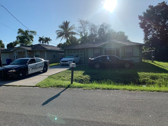 A patrol unit from the Fort Myers Police Department sits guard at a home on French Street in the Dunbar section of the city, Earlier Wednesday crime scene tape cordoned off the home.