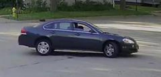 The suspect fired at this gray Impala, police say