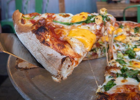 Cheese curds as a pizza topping are among the options at Wild Tomato Wood-Fired Pizza and Grille in Door County.