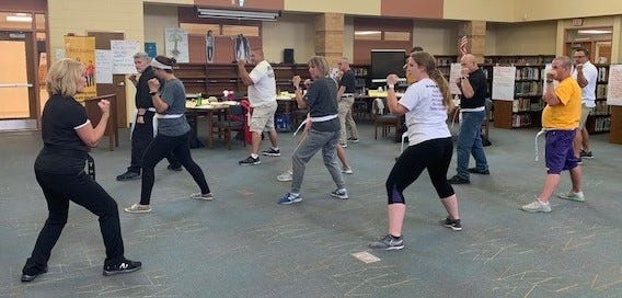 Teachers and law enforcement members from Kewaunee and Door counties receive taekwondo training last week at Kewaunee Elementary School to learn how to teach COREMatters Project classes to local middle school students.