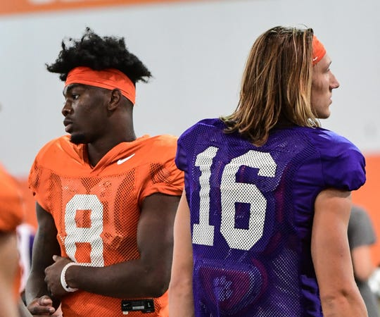 Clemson wide receiver Justyn Ross (8), left, and quarterback Trevor Lawrence (16) get ready for stretching during practice at the Poe Indoor Facility at Clemson Tuesday, August 20, 2019.
