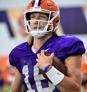 Clemson's Trevor Lawrence warms up during practice Aug. 20, 2019.