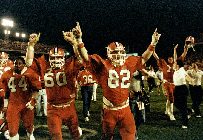 Clemson players celebrate after the Tigers defeated Nebraska 22-15 in the Orange Bowl on January 1, 1982.