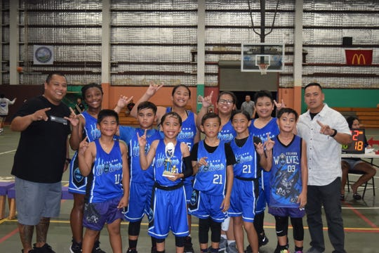 The Wolves Blue took third place in the Under-12B division of the Guam Youth Basketball Association Tuesday night at the Astumbo Gym.