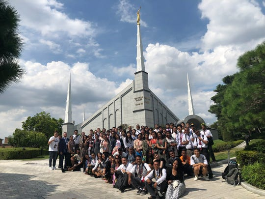 Nearly 100 young adults from Palau, Chuuk, Yap, Pohnpei, Kosrae, Guam and Saipan joined with 1,400 other young adults from Japan and Korea to attend a conference held Aug. 15-17 at Gyeonggi University in Seoul, Korea.  The conference was sponsored by The Church of Jesus Christ of Latter-day Saints and offered the opportunity for the young adults to participate in cultural exchanges and join in other uplifting activities.  Pictured is the participants in front of the LDS Temple in Seoul, Korea.