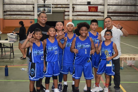 The Wolves Black took third place in the Under-12A division of the Guam Youth Basketball Association Tuesday night at the Astumbo Gym.