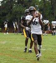 Golden Eagles wide receiver Quez Watkins, junior, runs a drill with