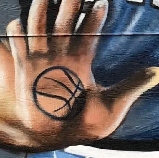 Basketball tattoo on the palm of Larry Bird