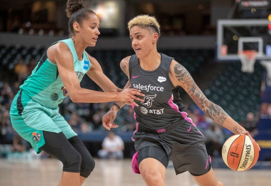 Candice Dupree of the Indiana Fever works a possession against a New York player during game action against New York, Bankers Life Fieldhouse, Indianapolis, Tuesday, Aug. 20, 2019. Indiana lost 82-76 and is in a three way tie for ninth place, one position away from playoff eligibility.