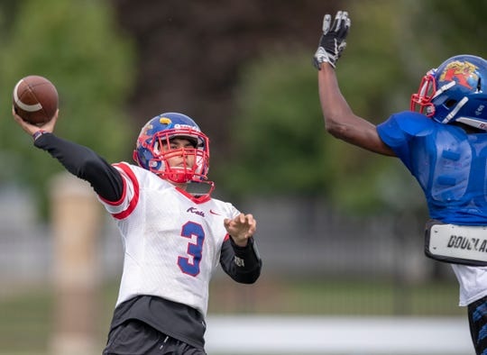 Andres Begne, an exchange student quarterback from Mexico City, practices with his team at Kokomo High School, Wednesday, Aug. 21, 2019. He said that he tried soccer as a kid, but had more affinity for American football, as his home country has a loyal fan base and a number of universities that play it in Mexico.