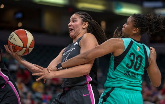 Natalie Achonwa of the Indiana Fever grabs a rebound against Tanisha Wright of the New York Liberty during game action against New York, Bankers Life Fieldhouse, Indianapolis, Tuesday, Aug. 20, 2019. Indiana lost 82-76 and is in a three way tie for ninth place, one position away from playoff eligibility.