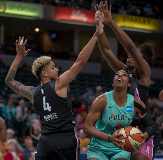 Candice Dupree of the Indiana Fever works defense with teammate Teaira McCowan of the Indiana Fever during game action against New York, Bankers Life Fieldhouse, Indianapolis, Tuesday, Aug. 20, 2019. Indiana lost 82-76 and is in a three way tie for ninth place, one position away from playoff eligibility.