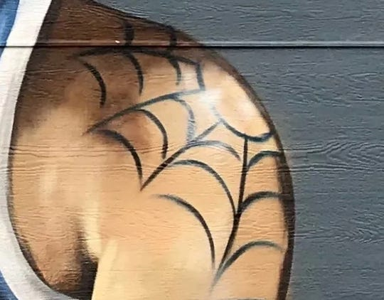 The spiderweb on Larry Bird's left shoulder.