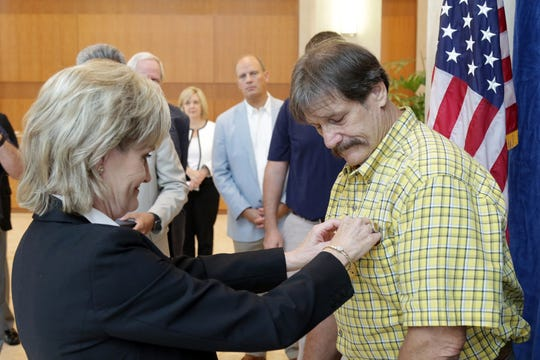 "John ""Jay"" Fulton Blount, Jr., of Greenville, receives the Secretary of Defense Medal for the Defense of Freedom from U.S. Senator Cindy Hyde-Smith Tuesday in Jackson."