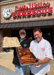 "Warren Wright, left, owner of Little Willie's BBQ, and Jim Clark, also known as ""Big Jim,"" display some of the foods that will be available at the new Little Willie's BBQ  in the Gluckstadt area of Madison. Clark is the head chef and butcher at the new location."