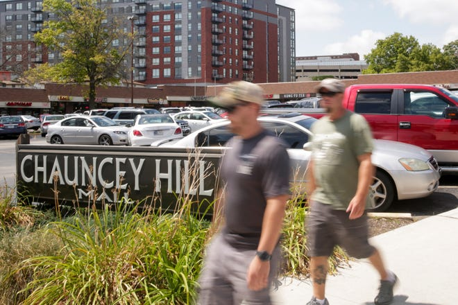 Pedestrians walk past the Chauncey Hill Mall, Wednesday, Aug. 21, 2019 in West Lafayette.