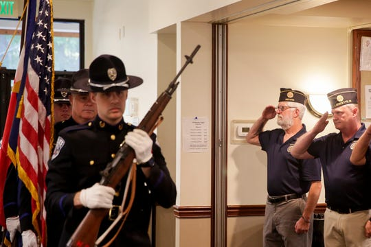 Veterans salute as the Lafayette Police department honor guard parades the colors during a press conference announcing the creation of a new organization to plan honor flights for veterans, Wednesday, Aug. 21, 2019 at American Legion Post 11 in Lafayette.
