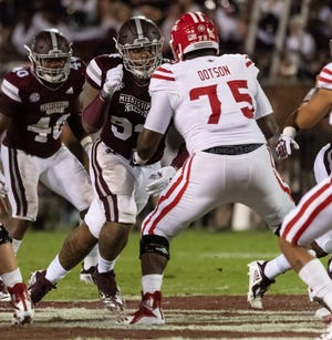 UL offensive lineman Kevin Dotson blocks Mississippi State defensive lineman Jeffery Simmons during last season's game.