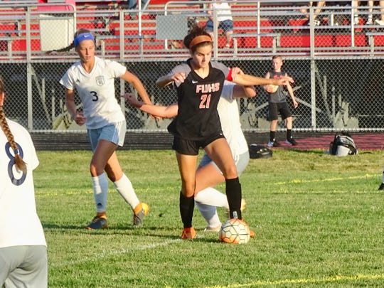 Fairfield Union senior Amelia Stansberry keeps the ball away from a Lancaster defender.