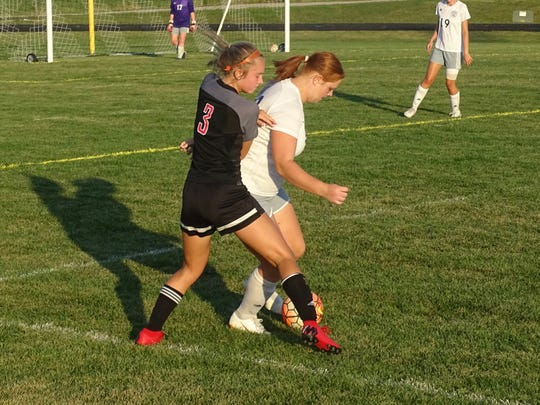 Fairfield Union's Caroline Brown fights for the ball against Lancaster. The Falcons defeated the Gales, 5-2.
