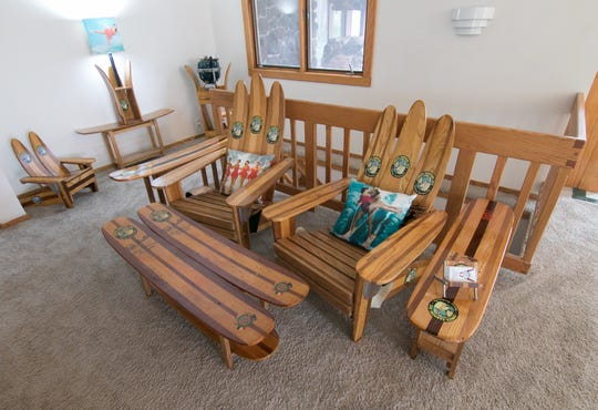 Harold Cole has furnished areas of his Tyrone Township home, shown Wednesday, Aug. 21, 2019, with furniture he makes from vintage water skis.