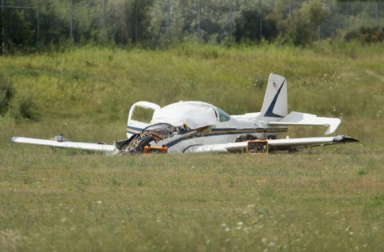 The plane that crashed Tuesday, killing the pilot and a mechanic on board, remains on the Spencer J. Hardy Airport grounds Wednesday, Aug. 21, 2019.