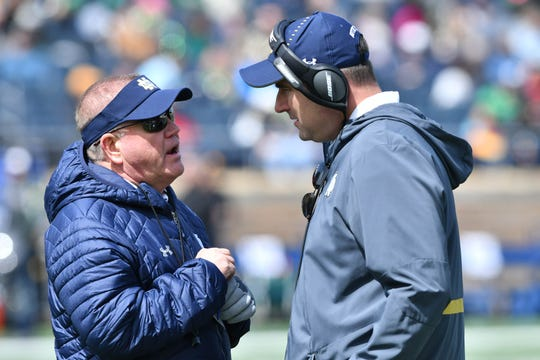 Apr 13, 2019; Notre Dame, IN, USA; Notre Dame Fighting Irish head coach Brian Kelly talks with Defensive line coach Mike Elston in the third quarter of the Blue-Gold Game at Notre Dame Stadium. Mandatory Credit: Matt Cashore-USA TODAY Sports