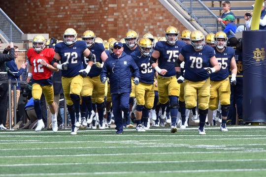 Apr 13, 2019; Notre Dame, IN, USA; Notre Dame Fighting Irish head coach Brian Kelly leads his players onto the field before the Blue-Gold Game at Notre Dame Stadium. Mandatory Credit: Matt Cashore-USA TODAY Sports
