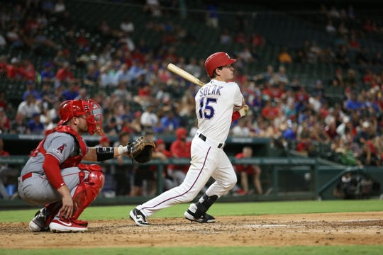 Texas Rangers second baseman Nick Solak bats against the Los Angeles Angels on Tuesday, Aug. 20, 2019, at Globe Life Park in Arlington, Texas.