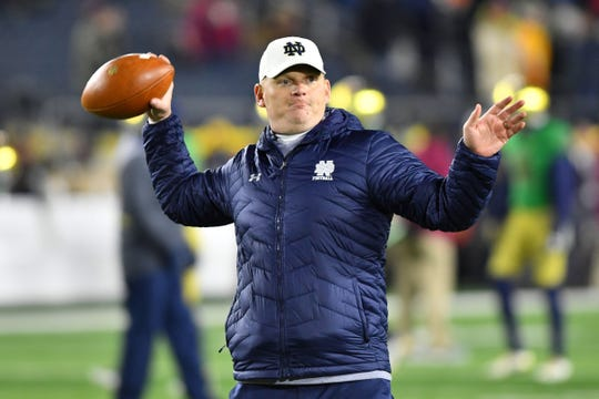 Nov 10, 2018; South Bend, IN, USA; Notre Dame Fighting Irish offensive coordinator Chip Long works with players during warmups before the game against the Florida State Seminoles at Notre Dame Stadium. Mandatory Credit: Matt Cashore-USA TODAY Sports