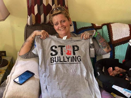 Joanna Wohlfert, mother of Michael Martin, an Everett High School eighth grader who killed himself earlier this year after months of bullying at school, holds up a T-shirt she'll wear during a walk for suicide prevention next month.