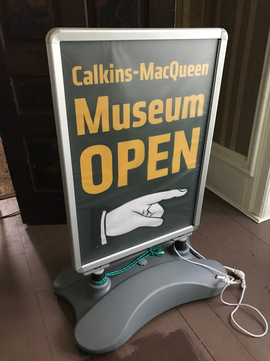 A sign stored at the Calkins-MacQueen house Aug. 20, 2019. The future of the house, owned by the city of Perry, is in question.