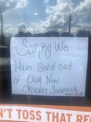 A sign at the Popeyes Louisiana Kitchen at 4324 Saginaw Hwy., Lansing, informs customers that they are sold out of the restaurant's new chicken sandwiches.