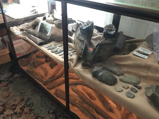Mastodon bones discovered in Perry Township in 2001 are displayed at the Calkins-MacQueen Museum in Perry Aug. 20, 2019.