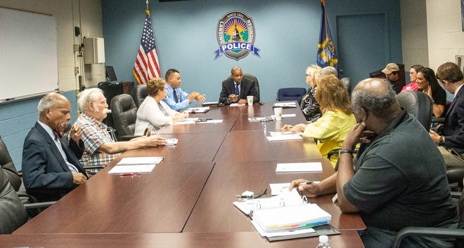 Lansing's Board of Police Commissioners approves the mayor's appointment of Daryl Green as police chief during its meeting, Tuesday, August 20, 2019, Lansing Michigan.