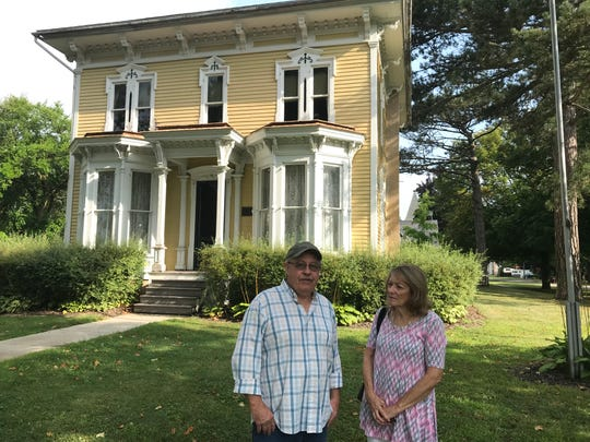 Billy Roback and Teresa Schanski, officers in the Perry Historical Society, shown outside the Calkins-MacQueen House in Perry Aug. 20, 2019. The historical society wants to save the house.