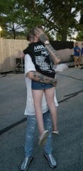 Aaron Carter and Autumn Porter, 8, of Ontario, hug in August at the Indiana State Fair.