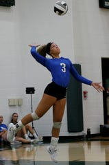 Ontario's Carleigh Pearson serves the ball during a match at Madison. The Lady Warriors started the season 3-0 by dropping just two sets in three games to begin the season.