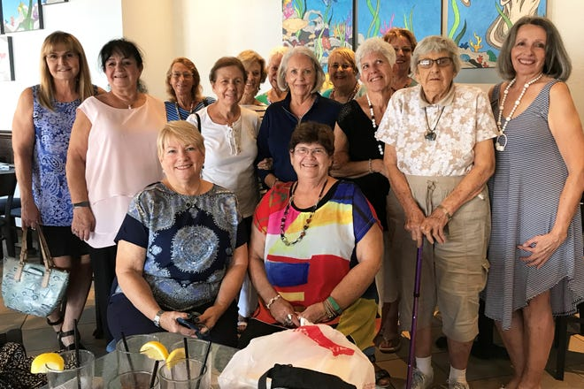 """On Wednesday, Aug. 7, members of Calusa Garden Club met for lunch at CJ's On The Bay.  Members discussed their plans for the 2019-2020 Calusa Garden Club programs. Also, they consulted with CJ's on the care of tillandsia plants (""""air plants"""") that CJ's has recently placed in glass orbs and hung on the back wall of the restaurant. From left, front: Sara Wolf and Lindy Kowalczyk; middle: Eva Kubinsky, Jean Voxakos, Barbara Messner, Marcia Riss, Marianne Foley,  Virginia Reade and Kathy McNabb; back: Linda Chute, Jackie Purvis, Mary McIntosh, Sue Oldershaw and Susan Neustadt."""