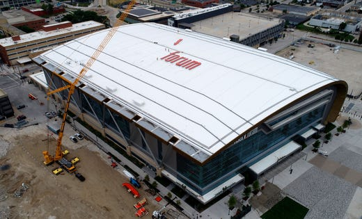 Jones Sign Co. installing giant Fiserv Forum sign on the Milwaukee Bucks arena's roof