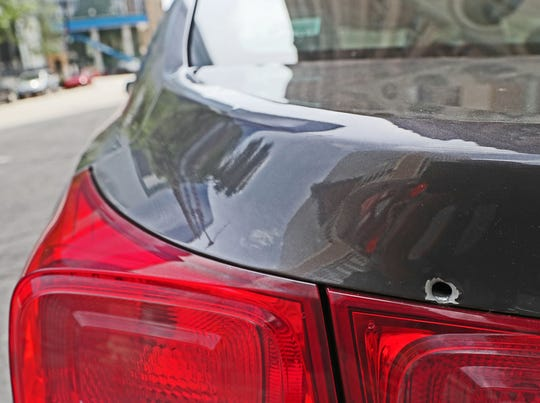 A bullet hole is clearly visible on the trunk lid of Ald. Cavalier Johnson's car Wednesday outside City Hall.  Johnson said the car was struck by gunfire Tuesday outside his home on Milwaukee's northwest side. No one was hurt.